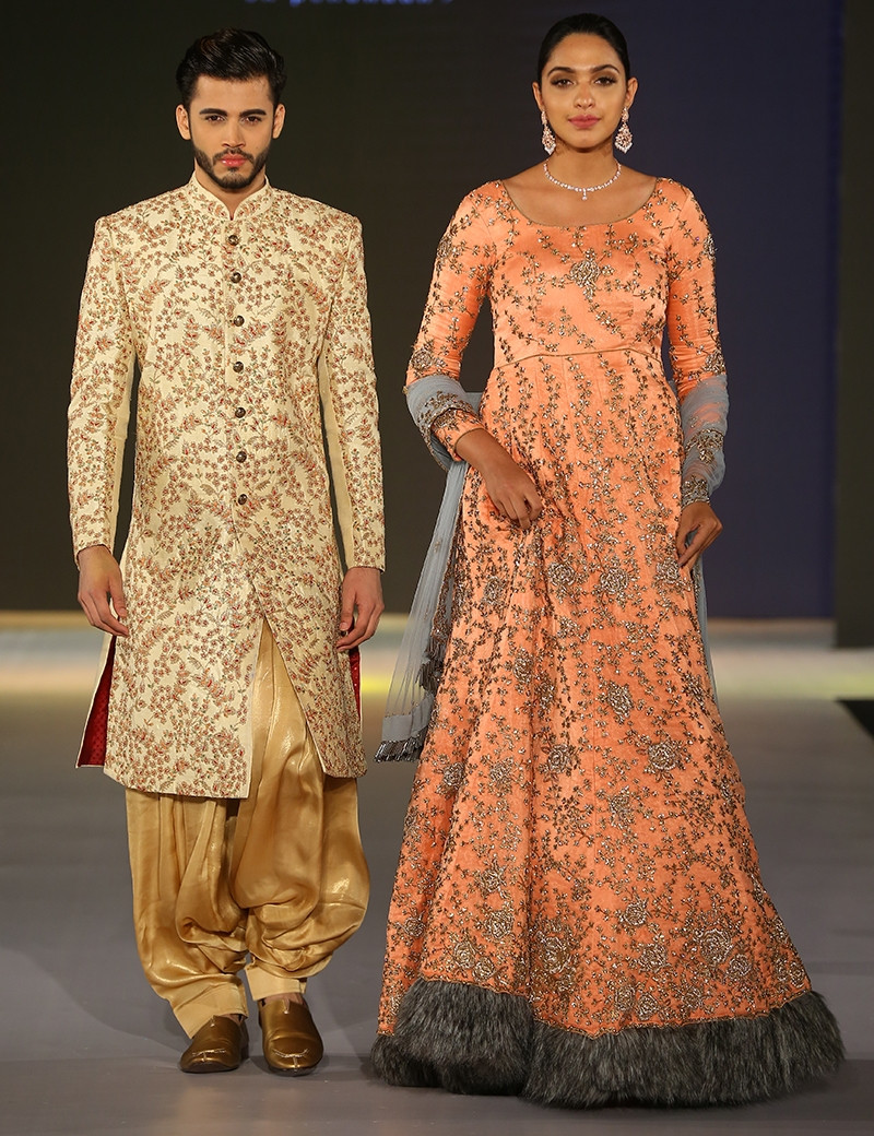 Scintillating Fur Gown & Sherwani Couple